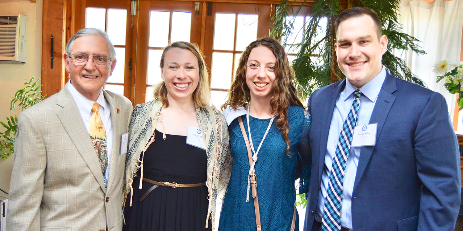 Dr. James Stewart poses with students Kaitlyn Moss, Erika Klemp, and Patrick Pilon at the Opportunity Scholarship reception