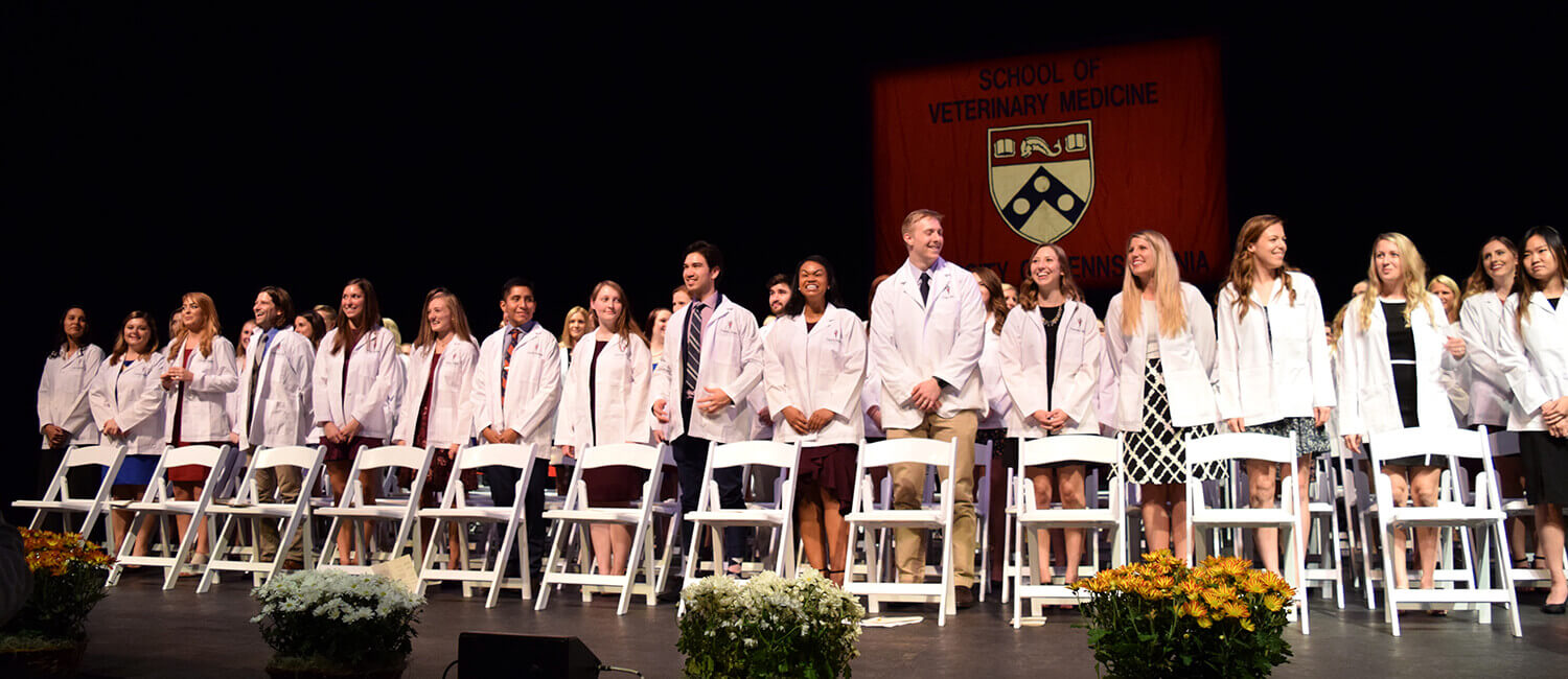 3rd Year VMD students receive their white coats for clinical rotations.