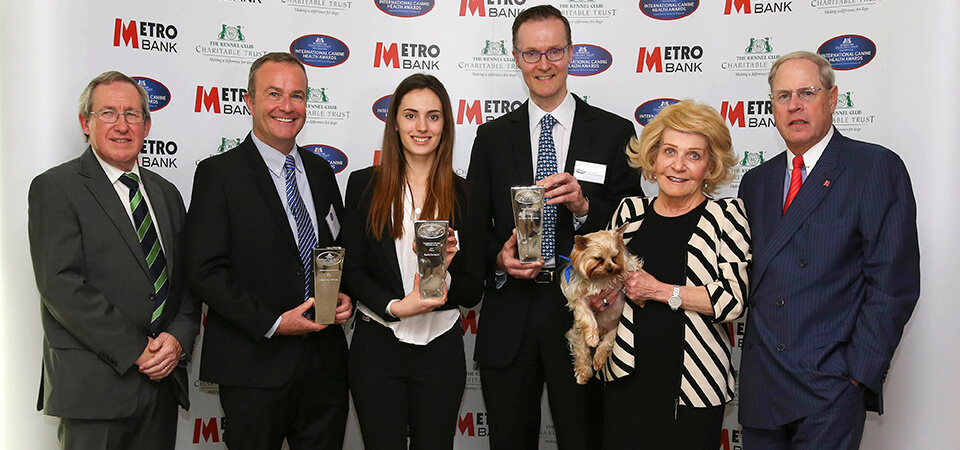 From L-R - Prof Steve Dean, Prof Paul McGreevy, Harriet Davenport, Prof Oliver Garden, Shirley and Vernon Hill with Sir Duffield the dog. Photo credit- The Kennel Club