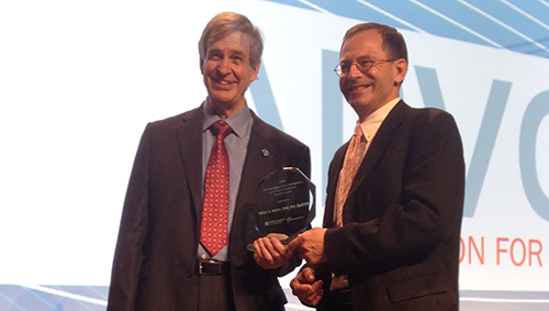 Dr. William Betran (r) receives the ARVO Foundation 2016 Pfizer Ophthalmics Carl Camras Translational Research Award.
