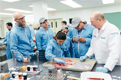 Penn Vet's Dr. Gary Althouse training Merck managers in swine reproduction.
