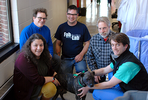 Pictured with Clubber, from left, are Dr. Evelyn Galban, Clinical Assistant Professor of Neurology and Neurosurgery at Penn Vet; Fab Lab's Stephen Smeltzer, Michael Stifel, and Dennis Pierattini; and Penn Vet neurology resident Dr. Jonathan Wood.