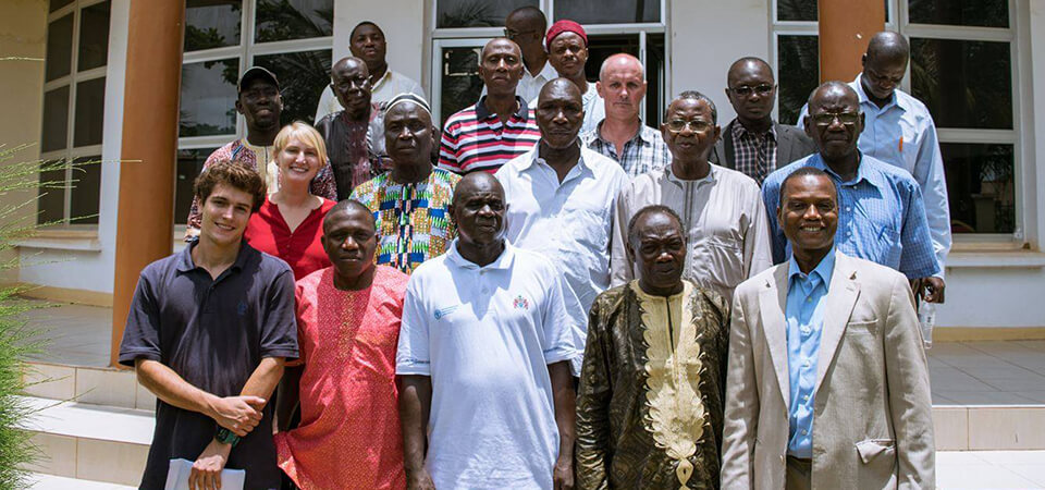 Parsons and Spies pose with key Gambian stakeholders