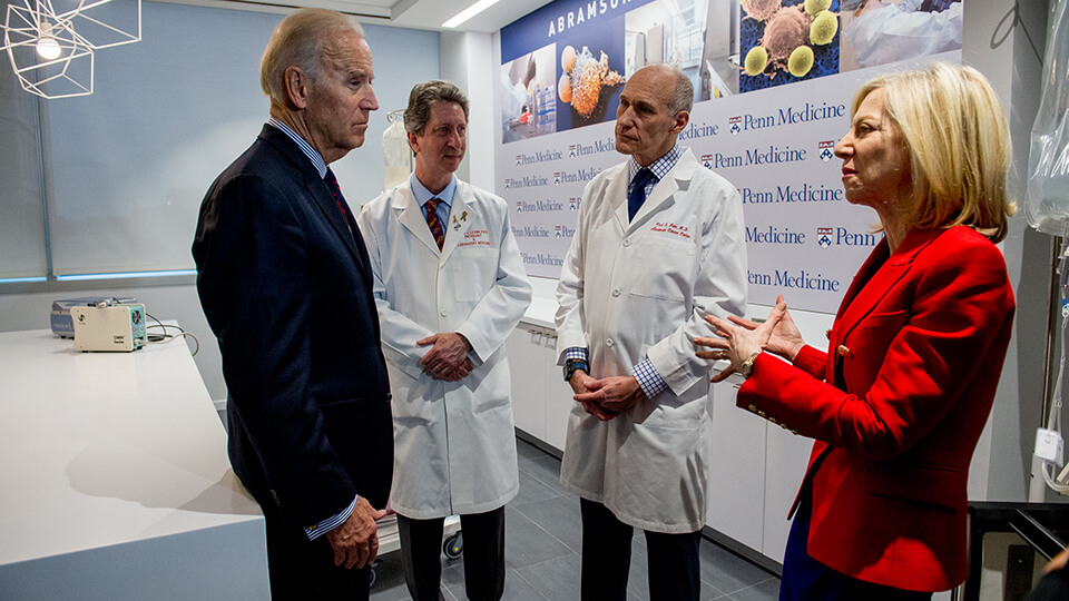 Former Vice President Joe Biden with Penn Medicine's Drs. Bruce Levine and Carl June and Penn President Dr. Amy Gutmann.