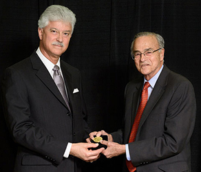 At right, Dr. Gustavo Aguirre receives the Proctor Medal from ARVO Board Trustee Steven J. Fliesler