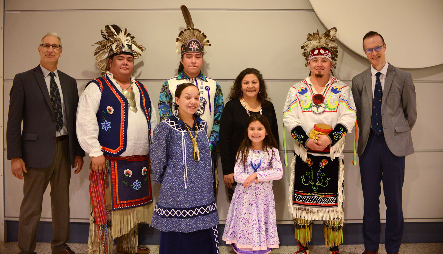 Flanked by Dean Andrew Hoffman (left) and Dr. Oliver Garden (right), members of the Iroquois Confederacy stand with Dr. Evelyn Galban (center, in black).