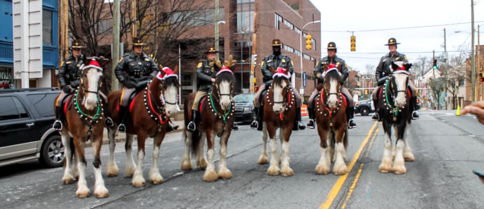 The New Castle County Mounted Patrol Unit getting into the holiday spirit. From left, Officer Annone on Warden, Officer Nicholson on Diesel, Corporal Shughart on Spartan, Officer Lockett on Seahawk, Sergeant Henasey on Elvis, and Corporal Crum on Wrangler
