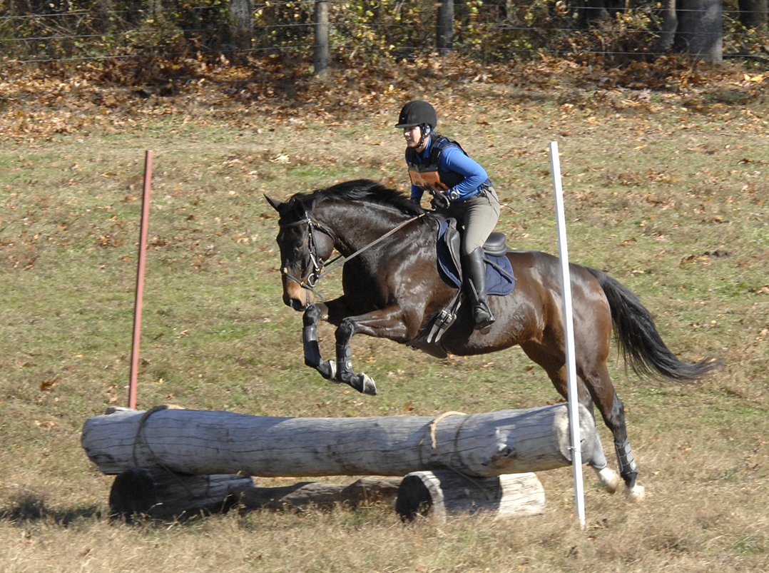 Monica and Tractor running the cross-country course at Waredaca in Maryland.