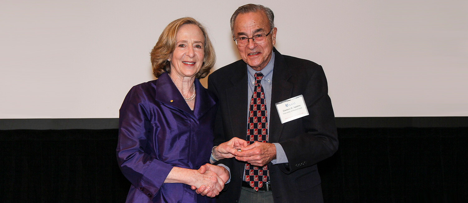 Dr. Gustavo Aguirre at the 2018 Fellows Forum receiving his award from Dr. Susan Hockfield, AAAS President. Photo courtesy of AAAS.