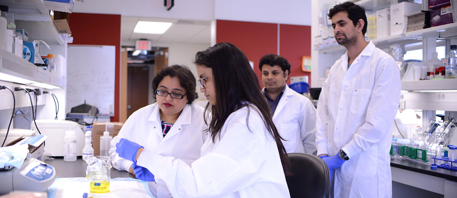 Dr. Rumela Chakrabarti (left) with her lab, including Sushil Kumar (far right).