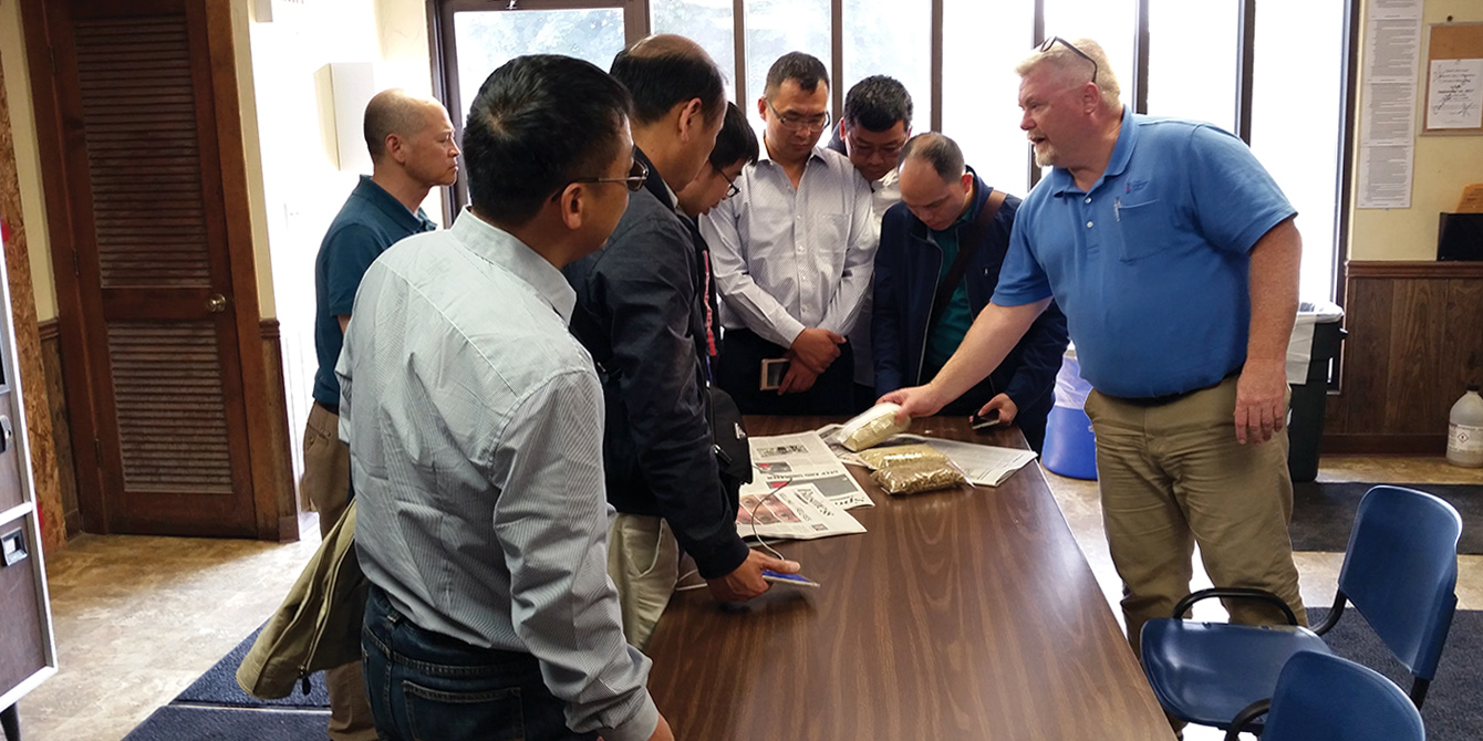 Chinese swine producers learn about quality control programs at Wenger Feeds in Rheems, Pa., as part of their visit with Penn Vet faculty.
