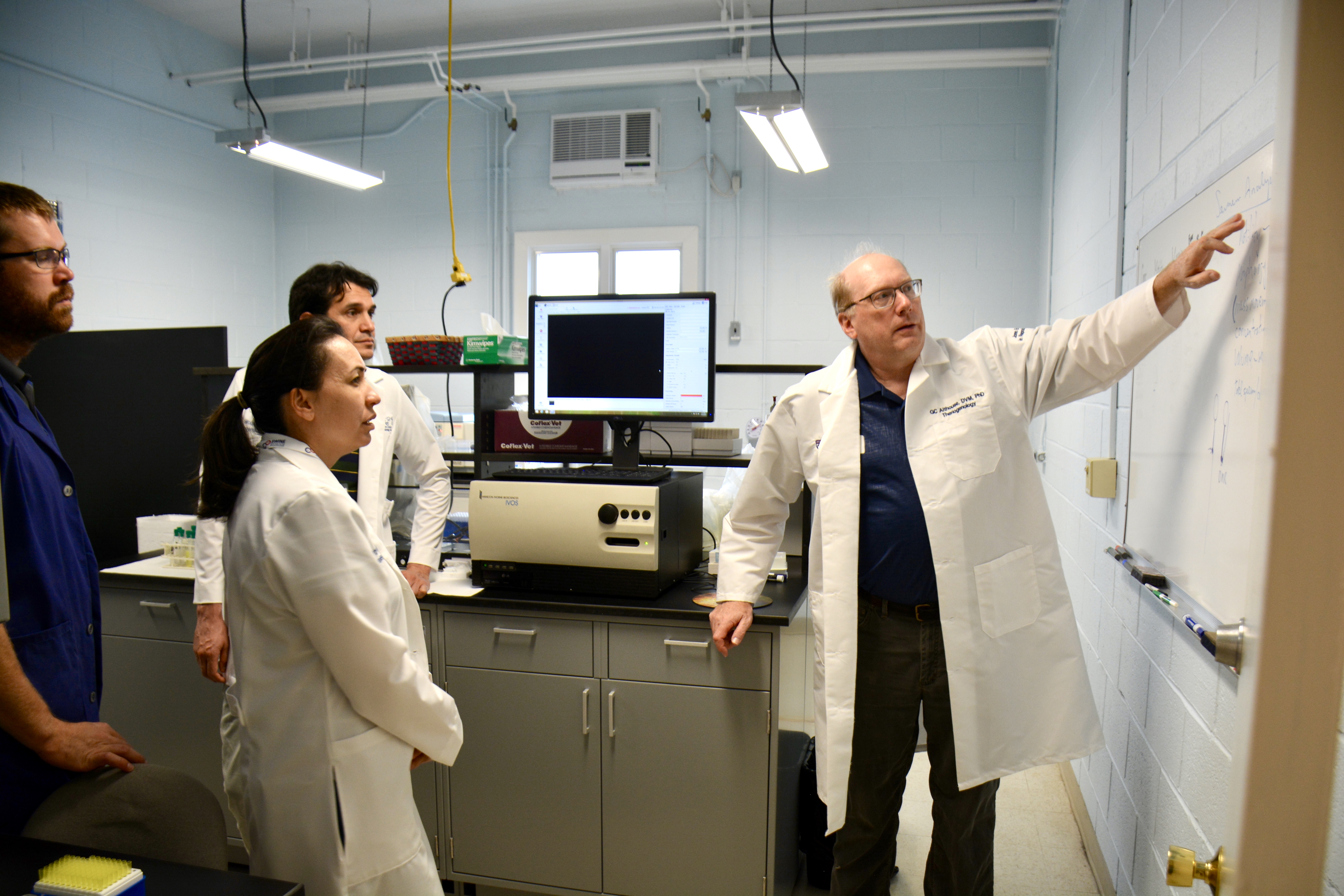 Dr. Gary Althouse explains key concepts to students during a hands-on lab.